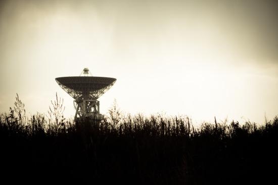 Radio telescope along in an open field
