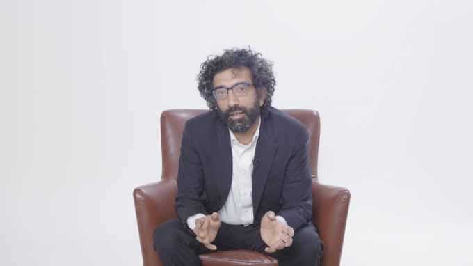 Bobby Kasthuri sitting in a leather armchair